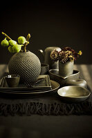 Autumnal arrangement with green figs on set table