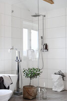 Shower area with glass screen and white wall tiles