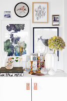 Vintage-style accessories on shelf below gallery of pictures