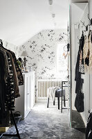 Floral wallpaper in dressing room with sloping ceiling