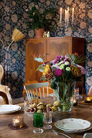 Autumnal decorations on table in old-fashioned dining room
