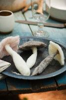 Felted mushrooms on plate on table