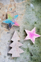 Wooden stars and Christmas tree coloured in by children