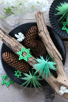 Festive arrangement of paper Christmas trees and bead stars