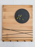 A homemade key rack made from a chopping board and a pinboard corner made from a cork coaster