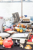 A mishmash of objects on a table at a flea market