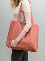 A woman with a homemade leather shopping bag