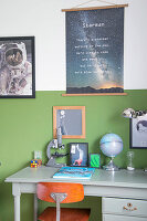 Two-tone wall and space-themed accessories in boy's bedroom