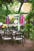Table set in bright colours on terrace for Mexican party