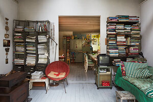 Improvised bookshelves in vintage-style open-plan interior