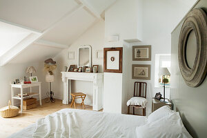 Vintage-style attic bedroom in natural shades