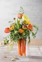 Bouquet of carrots, ranunculus and tulips