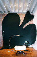 Large art installation of spades symbol on wall and floor
