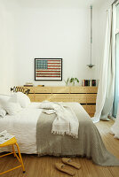 Picture of American flag in bedroom in natural shades
