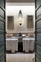 Washstand with twin countertop sinks in Oriental bathroom