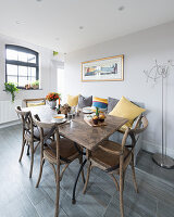 Bistro chairs and rustic wooden table in dining room