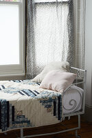 Quilt on metal bed