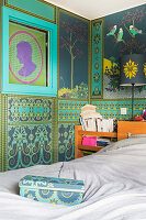 Bed in bedroom with ornate Oriental-style wallpaper