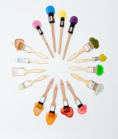 Paintbrushes and splodges of paint