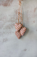 Gingerbread hearts hung on wall
