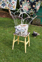 Wire basket of laundry on stool in garden