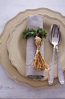Napkin ring handmade from box leaves and golden tassel
