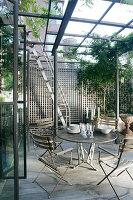 Garden furniture under pergola on roof terrace in New York