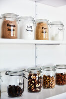 Hand-labelled storage jars of sugar and dried fruits