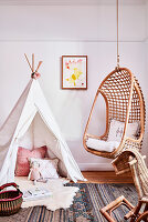 Play wigwam and hanging chair in child's bedroom