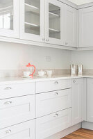 Cafetiere and cups in pale grey kitchen