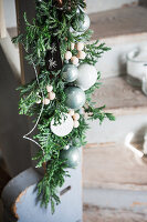 Garland of juniper branches, wooden beads and baubles