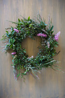 Green wreath with pink flowers