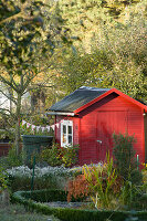 Allotment shed decorated with bunting in autumn