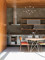 Dining area in kitchen with wood-clad walls