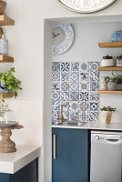 Blue-patterned tiles above sink in utility room