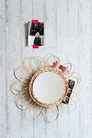 A mirror with a homemade wicker frame