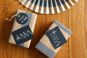 Hand-written name tags on wrapped gifts