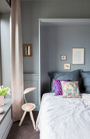 Fold-down bed in bedroom in shades of grey