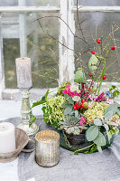 Autumnal arrangement of hydrangeas, sage, houseleeks, rose hips, sloes and poppy seed heads