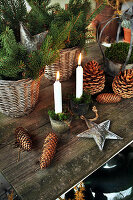 Christmas arrangement of fir sprigs, pine cones and candles