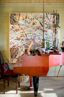 Red grand piano and abstract painting