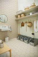 Tidy utility room in natural shades with honeycomb tiles