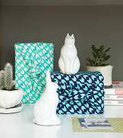 Gifts wrapped in patterned blue fabric and white ornaments