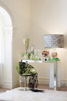 Buffet of sweets in sweet jars on mirrored console table