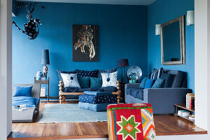 Seating area of blue living room