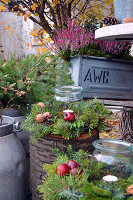Autumn decoration with broom heath and autumn wreaths