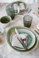 Table set with crockery in shades of blue and green