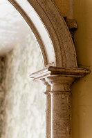 Detail of archway with peeling paint