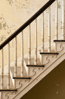 Old staircase with turned balusters in abandoned house