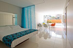 Modern studio apartment with white floor
